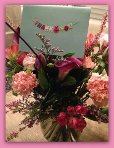 Bouquet of flowers and thank you card